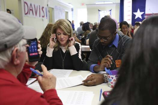 Senator Wendy Davis calls a voter with the help of volunteer Tahj Walker, right, at the phone bank at her campaign headquarters in Fort Worth on Tuesday, March 4, 2014. Photo: Lisa Krantz, San Antonio Express-News
