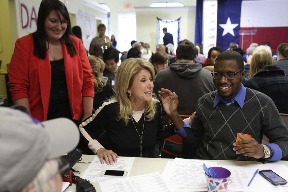 Senator Wendy Davis thanks volunteers including Tahj Walker, right, after she called voters at the phone bank at her campaign headquarters in Fort Worth on Tuesday, March 4, 2014. Photo: Lisa Krantz, San Antonio Express-News