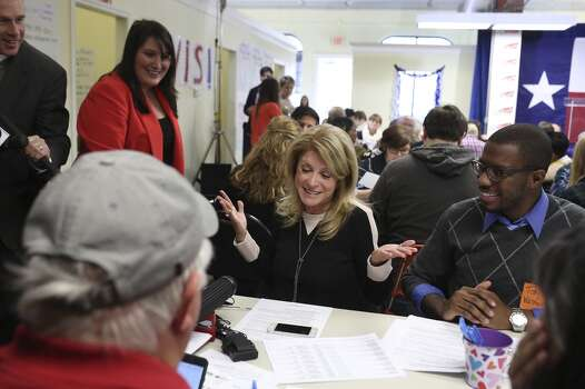 When asked by a member of the media, Senator Wendy Davis explains she didn't reach any of the voters she called and had to leave messages as she thanks volunteers and calls voters at the phone bank at her campaign headquarters in Fort Worth on Tuesday, March 4, 2014. Photo: Lisa Krantz, San Antonio Express-News