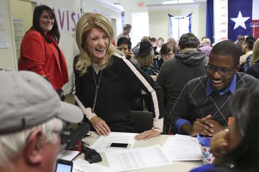 Senator Wendy Davis gets up after calling voters and thanking volunteers at the phone bank at her campaign headquarters in Fort Worth on Tuesday, March 4, 2014. Photo: Lisa Krantz, San Antonio Express-News