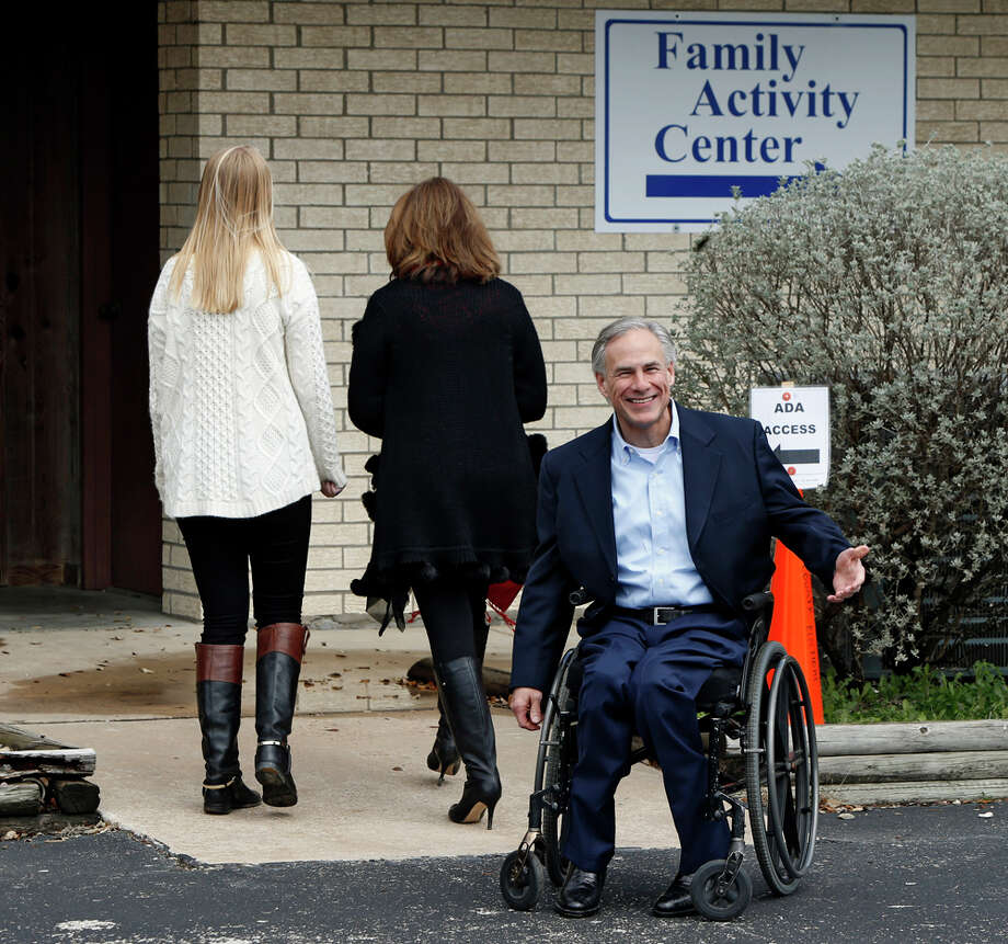 Republican candidate for governor, Texas Attorney General Greg Abbott is accompanied by his wife Cecilia, center, and daughter Audrey as he arrives to vote in the Texas primary at Western Hills Church of Christ on March 4, 2014 in Austin, Texas. Abbott is planning to make stops in Houston and Dallas for get out-the-vote rallies ahead of the elections. Photo: Erich Schlegel, Getty Images / 2014 Getty Images