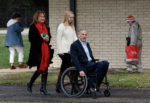 Republican candidate for governor, Texas Attorney General Greg Abbott is accompanied by his wife Cecilia, left, and daughter Audrey as he arrives to vote in the Texas primary at Western Hills Church of Christ on March 4, 2014 in Austin, Texas. Abbott is planning to make stops in Houston and Dallas for get out-the-vote rallies ahead of the elections. Photo: Erich Schlegel, Getty Images / 2014 Getty Images