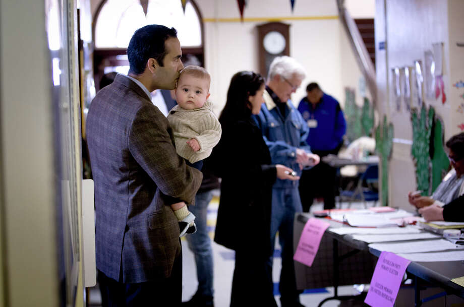 George P. Bush, kisses his son Prescott, as he turned out to vote in the primary election  Tuesday, March 4, 2014, at North High Mount Elementary School in Fort Worth, Texas. The 37-year-old nephew of former President George W. Bush, and son of former Florida Gov. Jeb Bush, is running for land commissioner in the state. Photo: Joyce Marshall, AP Photo/The Fort Worth Star-Telegram / The Fort Worth Star-Telegram