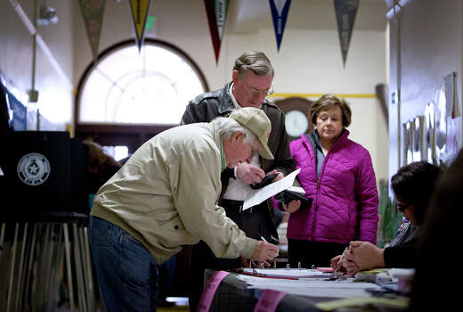 Voters prepare to vote in the primary election Tuesday, March 4, 2014, at North High Mount Elementary School in Fort Worth, Texas. Photo: Joyce Marshall, AP Photo/The Fort Worth Star-Telegram / The Fort Worth Star-Telegram