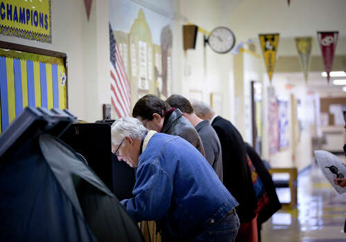 Voters including Tim Foreman turned out to vote in the primary election  Tuesday, March 4, 2014, at North High Mount Elementary School in Fort Worth, Texas. Photo: Joyce Marshall, AP Photo/The Fort Worth Star-Telegram / The Fort Worth Star-Telegram