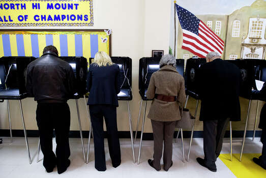 Voters casts ballots for the primary election Tuesday, March 4, 2014, at North High Mount Elementary School in Fort Worth, Texas. Photo: Joyce Marshall, AP Photo/The Fort Worth Star-Telegram / The Fort Worth Star-Telegram