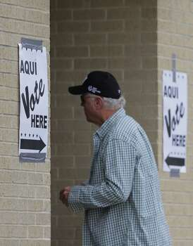 A voters arrives at a polling site, Tuesday, March 4, 2014, in San Antonio. Texas is holding the nation's first primary election Tuesday with a political free-for-all in Republican races that could push the state further right, though Democrats are calling it the next big battleground on the electoral map. Photo: Eric Gay, Associated Press