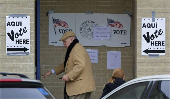 Voters arrive at a polling site, Tuesday, March 4, 2014, in San Antonio. Texas is holding the nation's first primary election Tuesday with a political free-for-all in Republican races that could push the state further right, though Democrats are calling it the next big battleground on the electoral map. Photo: Eric Gay, Associated Press