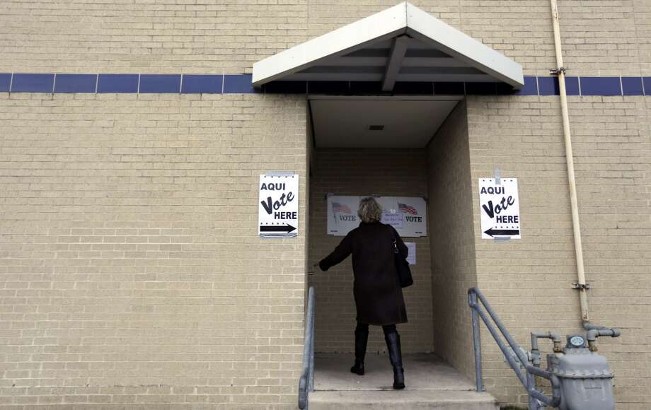 A voter arrives at a polling site, Tuesday, March 4, 2014, in San Antonio. Texas is holding the nation's first primary election Tuesday with a political free-for-all in Republican races that could push the state further right, though Democrats are calling it the next big battleground on the electoral map. Photo: Eric Gay, Associated Press