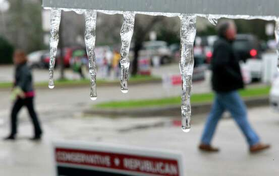 Icicles hang from a political sign as people arrive and leave from the polling place held at the Friendship Center Community Center, 2235 Lake Robbins Drive,  Tuesday, March 4, 2014 in The Woodlands.  ( Melissa Phillip / Houston Chronicle ) Photo: Melissa Phillip, Staff / © 2014  Houston Chronicle