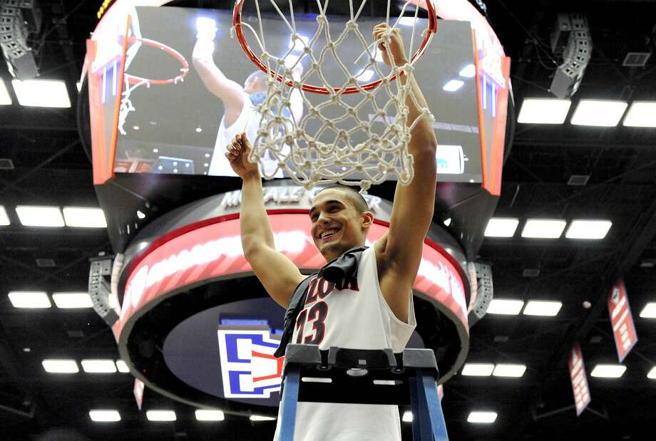 Arizona, with Nick Johnson, is one of only two Pac-12 locks for the NCAA Tournament. Photo: Casey Sapio, Reuters