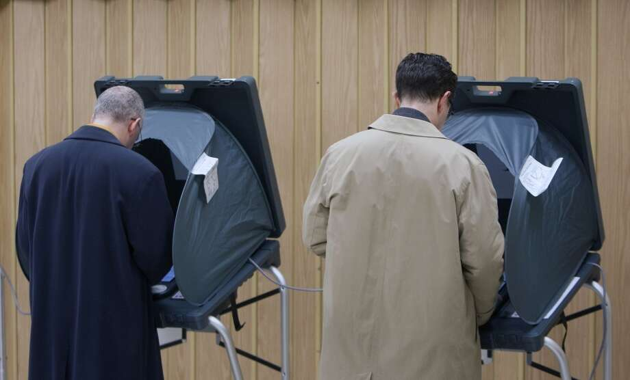 Voters cast their ballots at the Metropolitan Multi-Services Center, Tuesday, March 4, 2014, in Houston. (AP Photo/Houston Chronicle, Cody Duty) Photo: Cody Duty, Associated Press