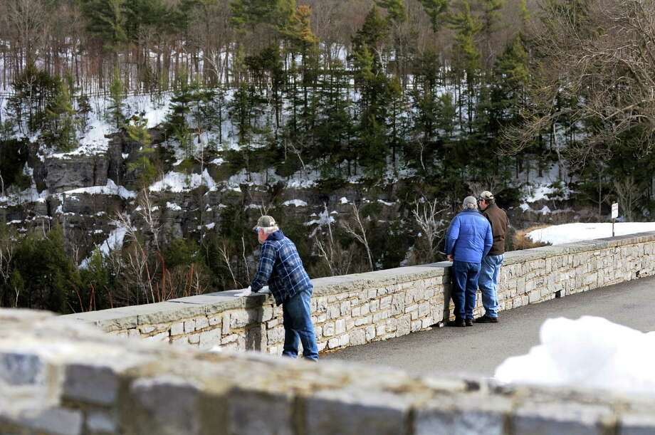 John Murray of Delmar, center, visits the Cliff Edge Overlook with friends Tony Stalling of Nantucket, Mass., left, and Brent Thomas of Crooksville, Ohio on Tuesday, March 4, 2014, at John Boyd Thacher State Park in New Scotland, N.Y. (Cindy Schultz / Times Union) Photo: Cindy Schultz / 00025996A