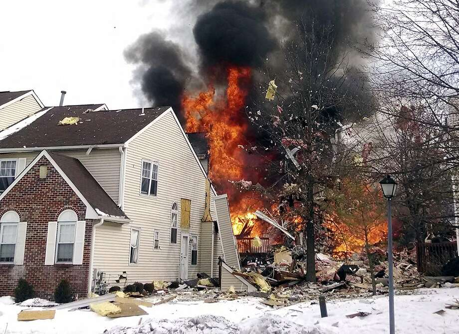 """Flames engulfa townhouse complex in Ewing, N.J., after a gas line damaged by a   contractor """"exploded like a bomb"""" At least seven people were injured and several homes   destroyed or damaged. Photo: Josh Forst, Associated Press"""