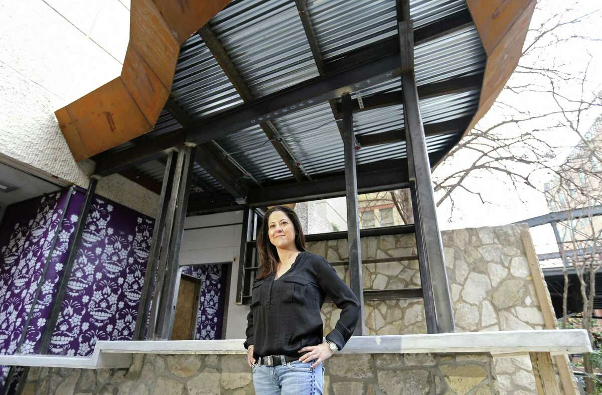 Lori Urbano, owner of Urbano Design & Build, stands near a bar she designed that is under construction at The Worm Tequila & Mezcal Bar on the River Walk. She is one of just a few Hispanic women who own construction companies in San Antonio