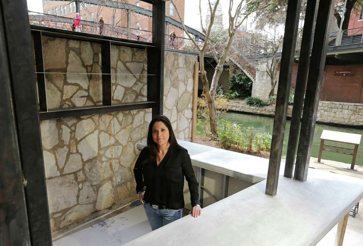 Portrait of Lori Urbano, owner of Urbano Design & Build, with the bar she designed that is under construction Monday March 3, 2014 at The Worm Tequila & Mezcal Bar.