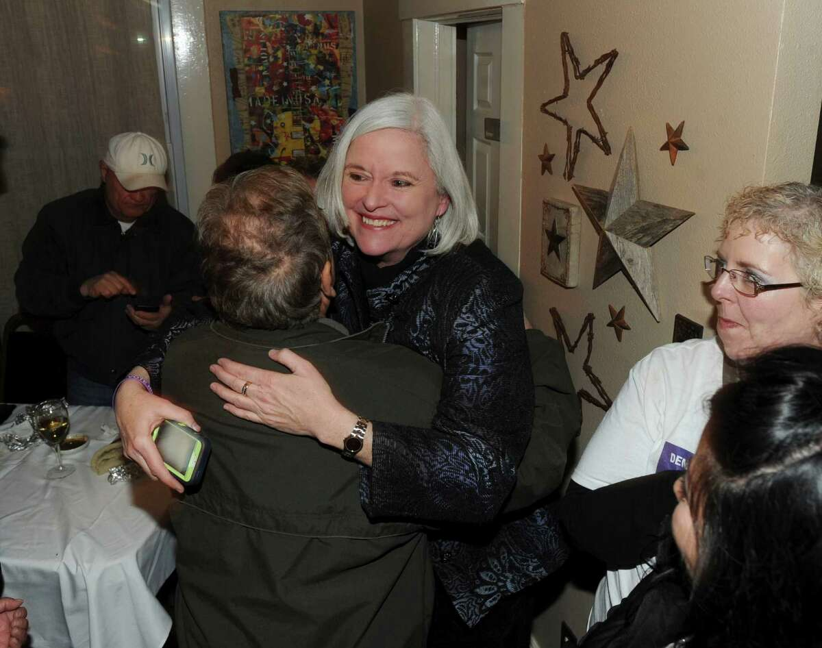 Therese Huntzinger, who is running in the Democratic primary for the office of District Attorney, is greeted by supporters at The Cove on Tuesday, March 4, 2014.