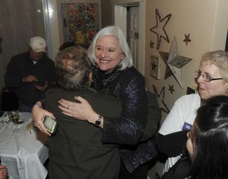 Therese Huntzinger, who is running in the Democratic primary for the office of District Attorney, is greeted by supporters at The Cove on Tuesday, March 4, 2014. Photo: Billy Calzada, San Antonio Express-News