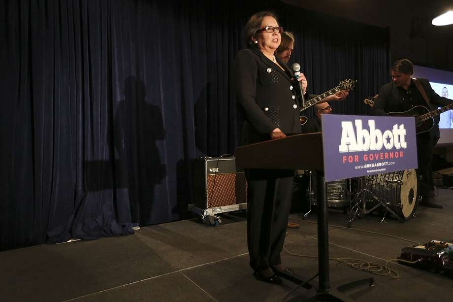 Former Secretary of State Hope Andrade addresses the crowd gathered for Texas Attorney General Greg Abbott at Aldaco's Sunset Station on primary election night, Tuesday, March 4, 2014. Abbott is scheduled to speak around 9 p.m. Photo: Jerry Lara, San Antonio Express-News
