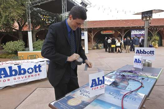 Texas Attorney General Greg Abbott field worker Robert Lane prepares tables at Aldaco's Sunset Station, Tuesday, March 4, 2014. Abbott is scheduled to speak at 8 p.m. Photo: Jerry Lara, San Antonio Express-News