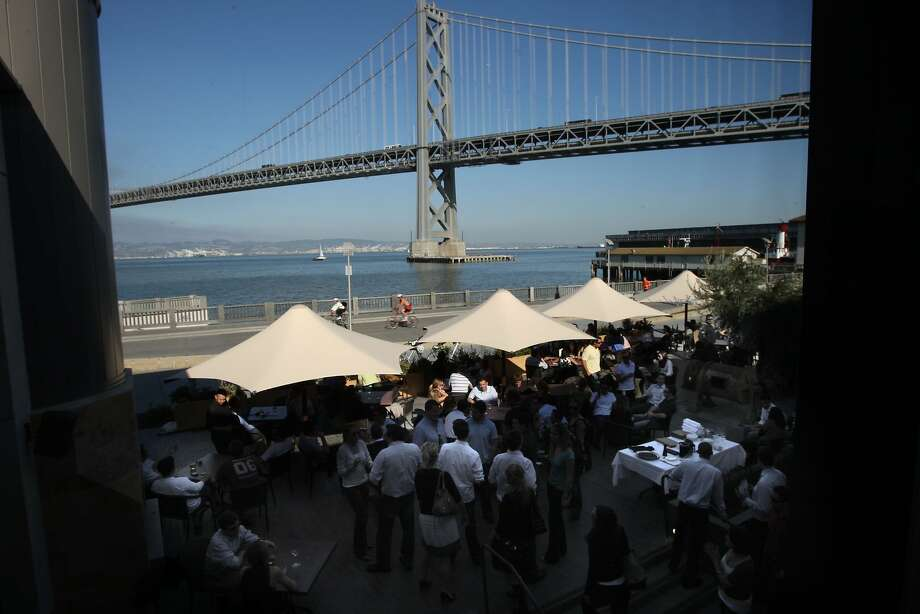 The outside patio of Epic Roasthouse restaurant on the waterfront features an unparalleled view of the Bay Bridge. Photo: Liz Hafalia, SFC