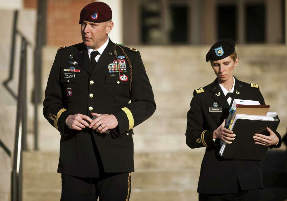 Army Brig. Gen. Jeffrey A. Sinclair (left) faces charges of fraud, forcible sodomy, coercion and inappropriate relationships. The married father admits he carried on a three-year extramarital affair with a junior officer, but denies any physical abuse. Photo: Andrew Craft / Associated Press / The Fayetteville Observer