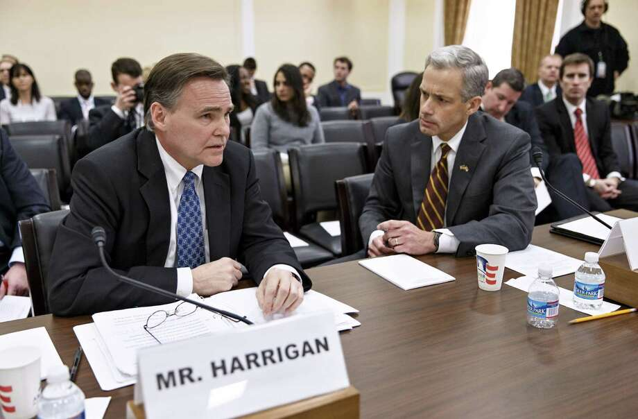 Thomas Harrigan, deputy administrator for the Drug Enforcement Administration (left), and John Walsh, U.S. attorney for the District of Colorado, prepare to testify on Capitol Hill. Photo: J. Scott Applewhite / Associated Press / AP