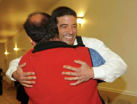 Nicholas LaHood, who is running in the Democratic primary for district attorney nomination, is greeted by friend Art Silva at San Antonio Professional Firefighters Banquet Hall on election night, Tuesday, March 4, 2014. Photo: Billy Calzada, San Antonio Express-News / San Antonio Express-News