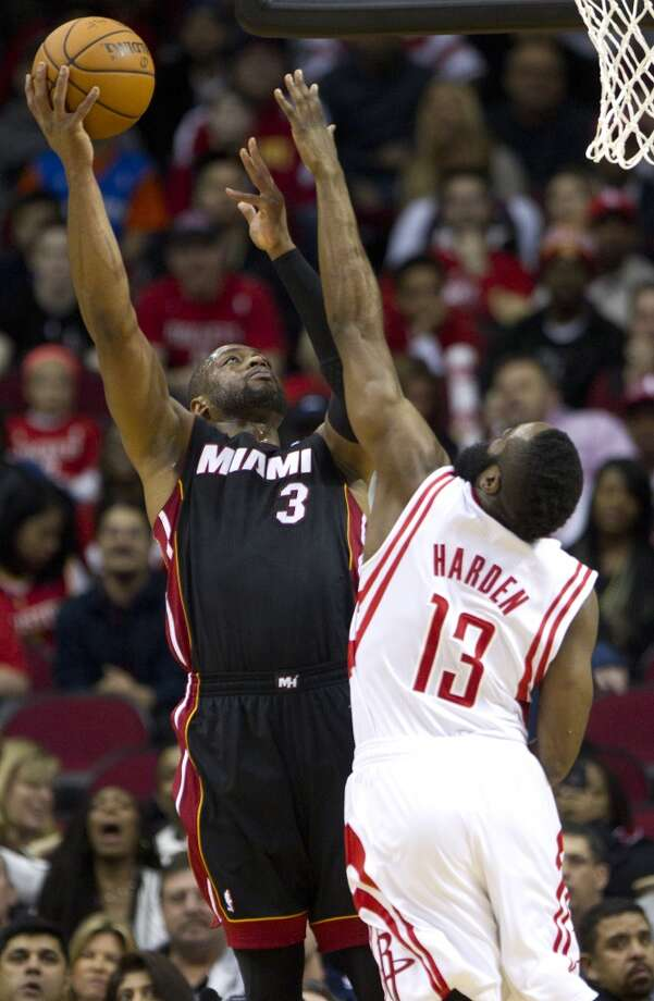 March 4: Rockets 106, Heat 103  Rockets shooting guard James Harden defends Dwyane Wade of the Heat. Photo: Brett Coomer, Houston Chronicle