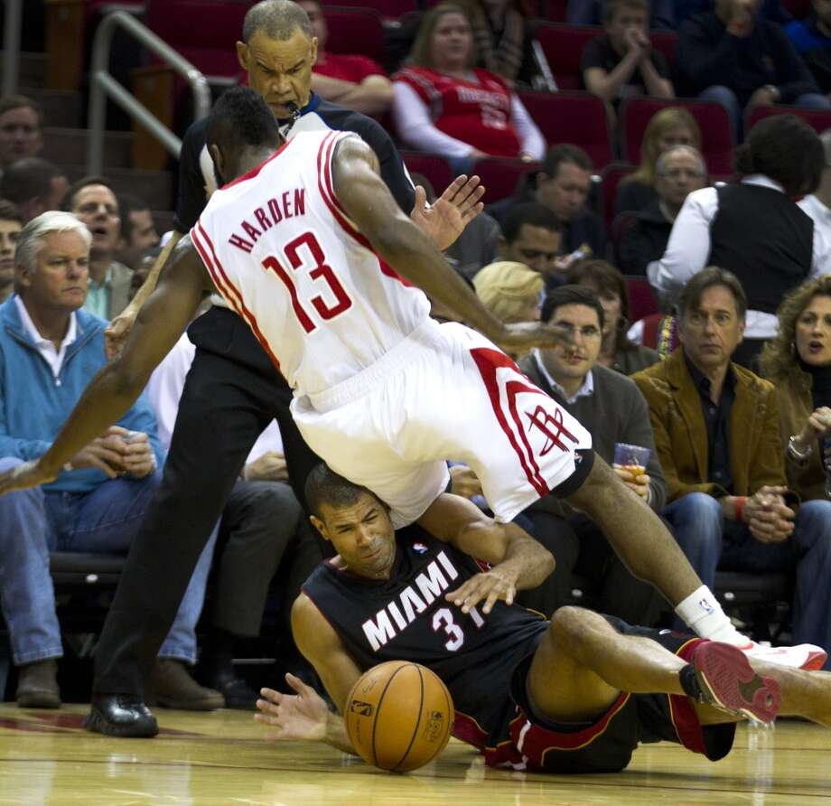 Rockets shooting guard James Harden falls over Shane Battier of the Heat. Photo: Brett Coomer, Houston Chronicle