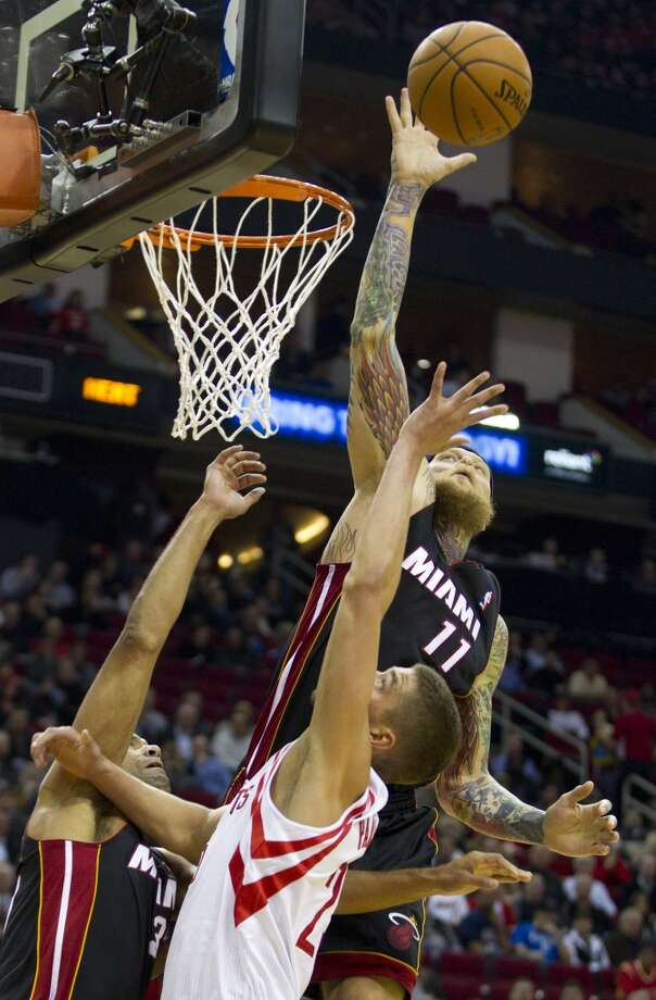 Chris Andersen of the Heat blocks a shot attempt from Rockets forward Chandler Parsons. Photo: Brett Coomer, Houston Chronicle