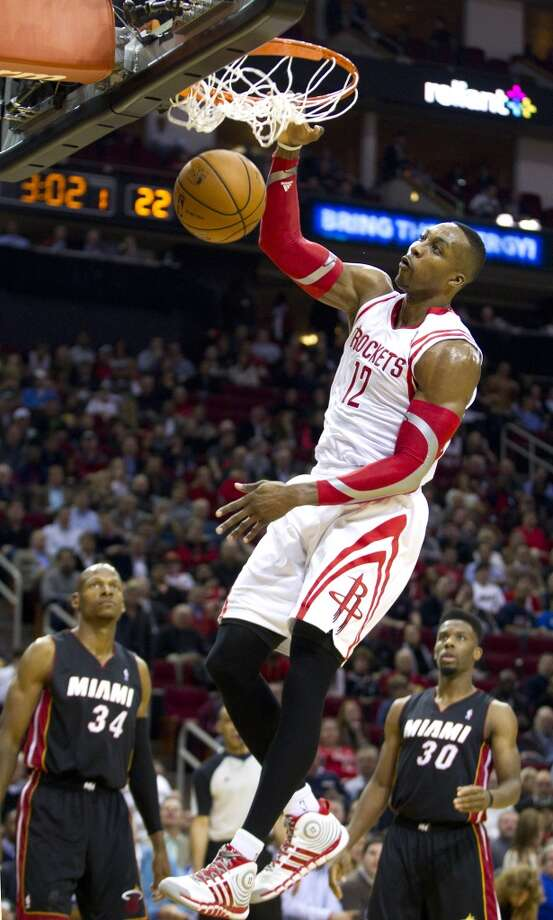 Rockets center Dwight Howard gets a dunk against the Heat. Photo: Brett Coomer, Houston Chronicle
