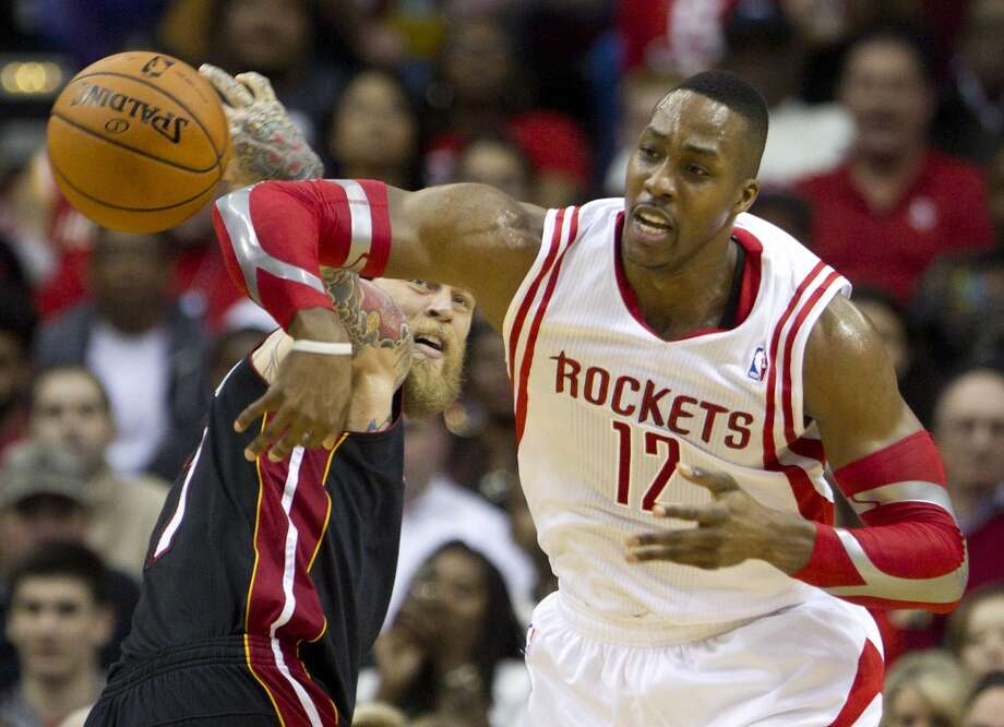 Rockets center Dwight Howard battles for possession with Chris Andersen of the Heat. Photo: Brett Coomer, Houston Chronicle