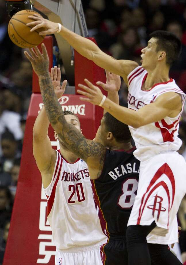 Rockets guard Jeremy Lin records a block against Michael Beasley of the Heat. Photo: Brett Coomer, Houston Chronicle