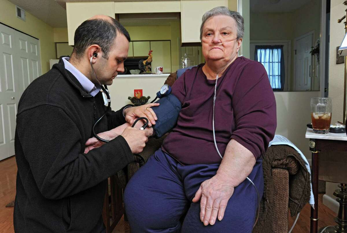 Dr. Christopher Domarew takes the blood pressure of 75 year-old patient Leona Mantellow during a house call as part of a new program on Monday, March 3, 2014 in North Greenbush, N.Y. (Lori Van Buren / Times Union)