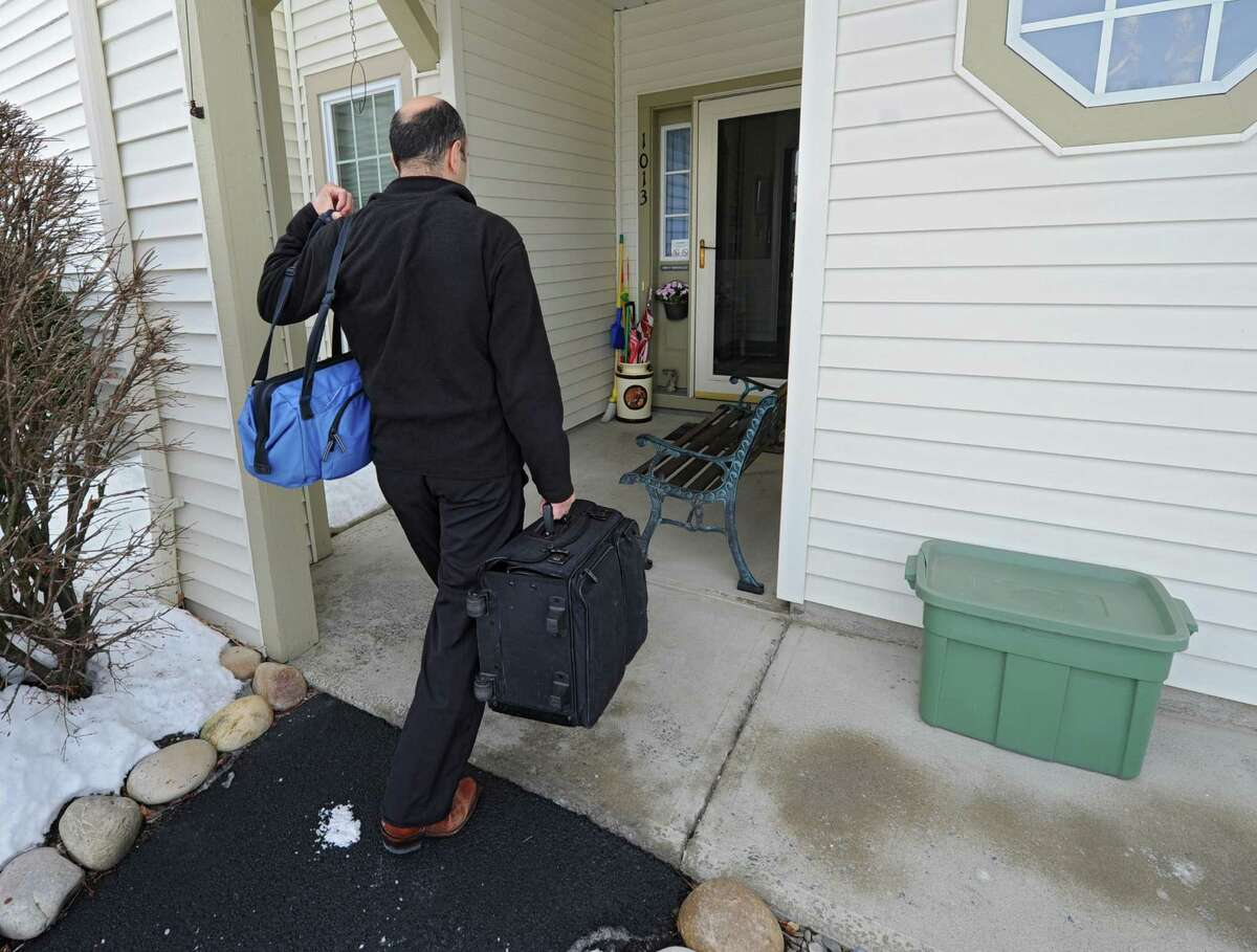 Dr. Christopher Domarew arrives at the home of patient Leona Mantellow during a house call as part of a new program on Monday, March 3, 2014 in North Greenbush, N.Y. (Lori Van Buren / Times Union)