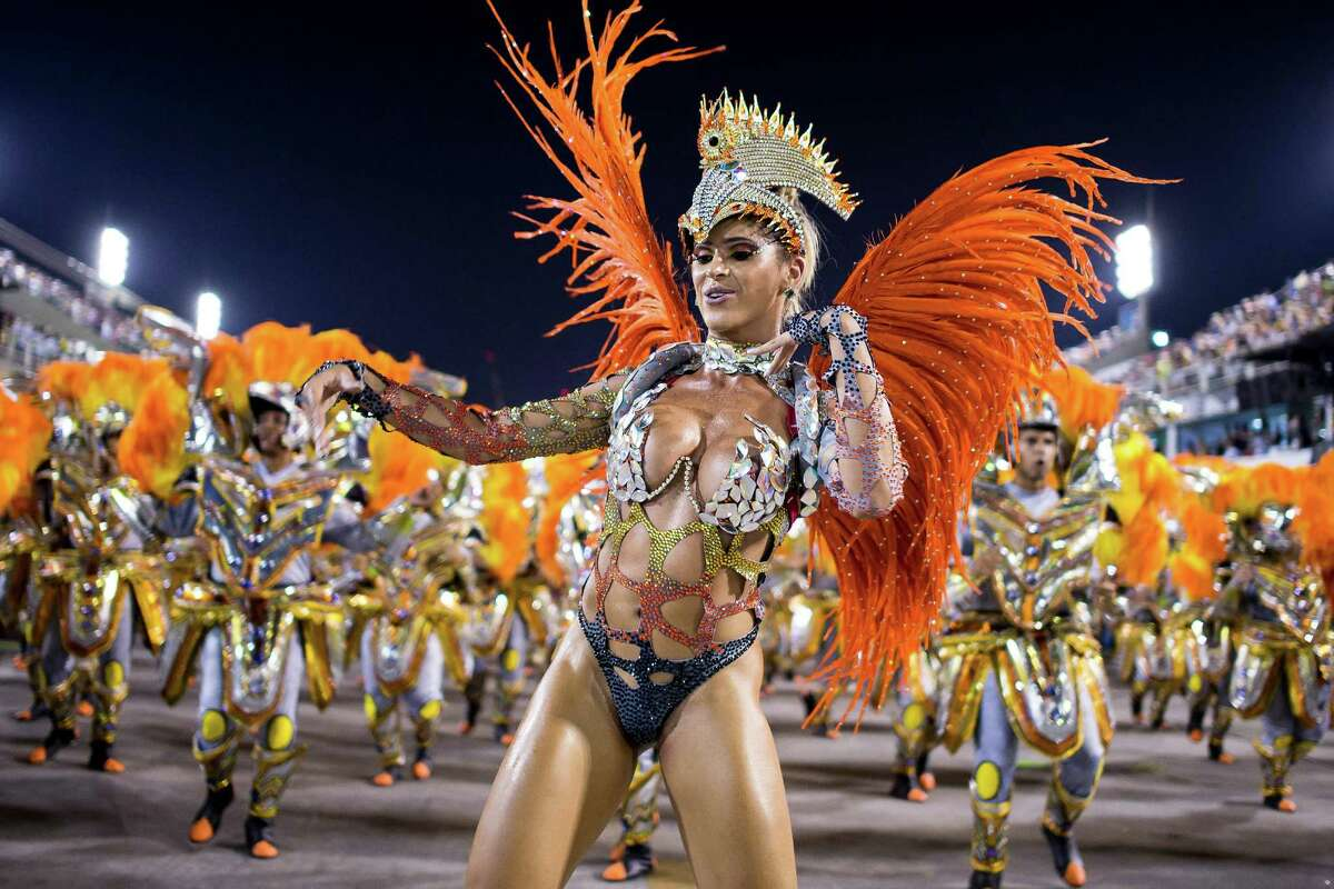 Members of Unidos da Tijuca Samba School during their parade at 2014 Brazilian Carnival at Sapucai Sambadrome on March 03, 2014 in Rio de Janeiro, Brazil. Rio's two nights of Carnival parades began on March 2 in a burst of fireworks and to the cheers of thousands of tourists and locals who have previously enjoyed street celebrations (known as
