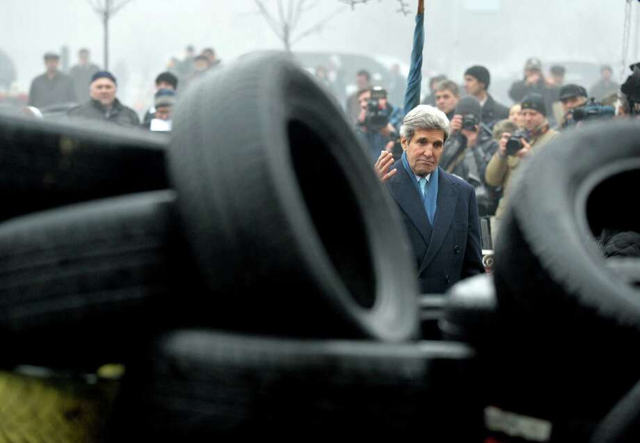 Secretary of State John Kerry walks near a barricade in Kiev, Ukraine. He brought a $1 billion aid package to a nation that is fighting to fend off bankruptcy. Photo: Sergei Supinsky / Getty Images / AFP