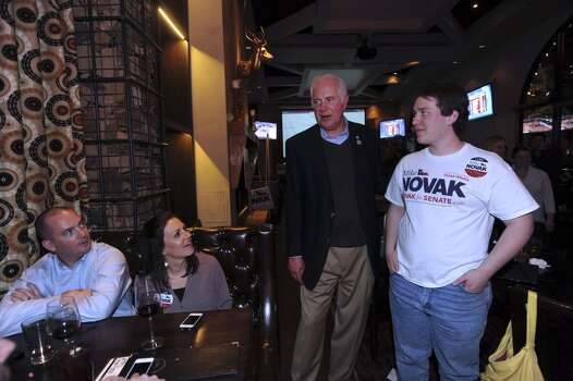 Mike Novak, one of three GOP candidates for Texas Senate District 25, second from right, speaks with Connor Pfeiffer, right, who is chairman of the High School Republicans of Texas, and Mike and Andrea Daniels at Stone Werks  on election night, Tuesday, March 4, 2014. Photo: Billy Calzada, San Antonio Express-News