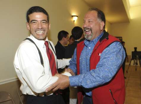 Nicholas LaHood, left, who is running in the Democratic primary for the district attorney nomination, is greeted by Art Silva at San Antonio Professional Firefighters Banquet Hall on election night, Tuesday, March 4, 2014. Photo: Billy Calzada, San Antonio Express-News
