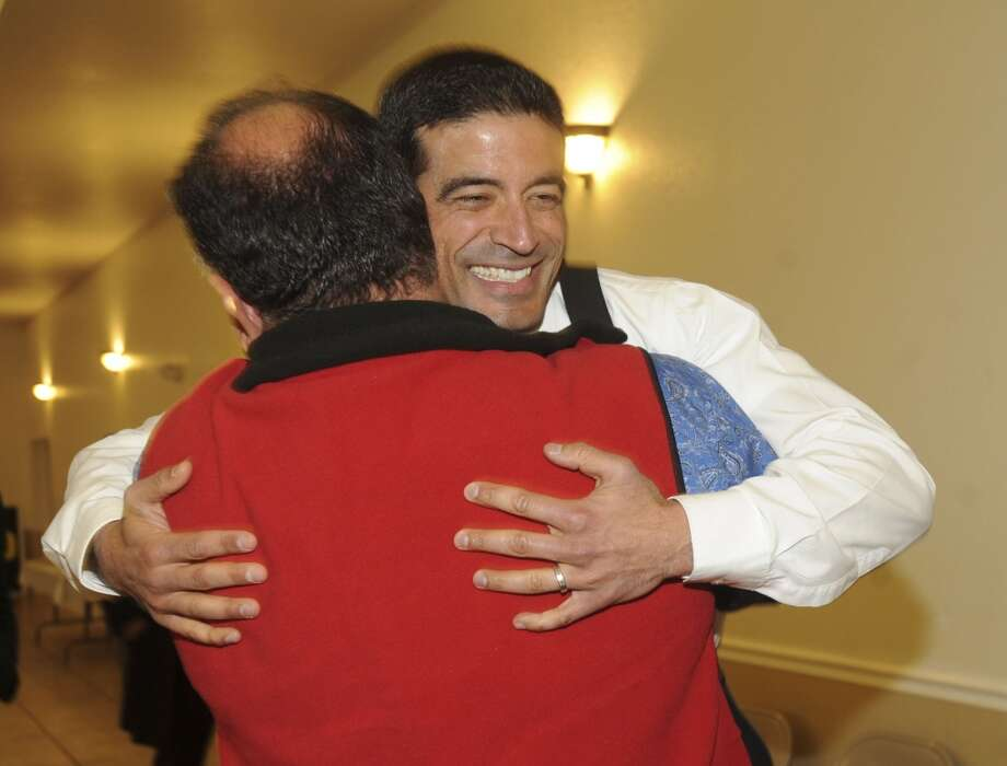 Nicholas LaHood, who is running in the Democratic primary for district attorney nomination, is greeted by friend Art Silva at San Antonio Professional Firefighters Banquet Hall on election night, Tuesday, March 4, 2014. Photo: Billy Calzada, San Antonio Express-News