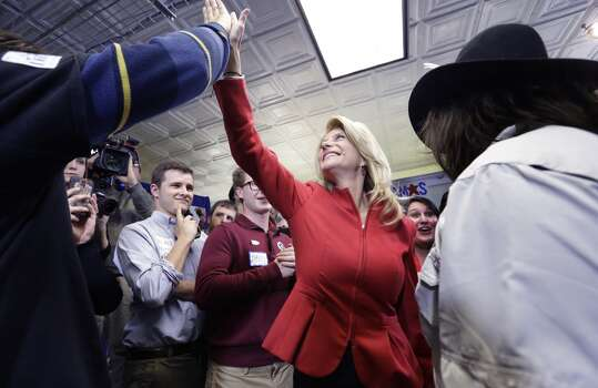 Texas Sen. Wendy Davis, D-Fort Worth, gets a high five from a supporter after speaking at her campaign headquarters Tuesday, March 4, 2014, in Fort Worth, Texas. Davis won the Democratic primary to run for Texas Governor. (AP Photo/LM Otero) Photo: LM Otero, Associated Press