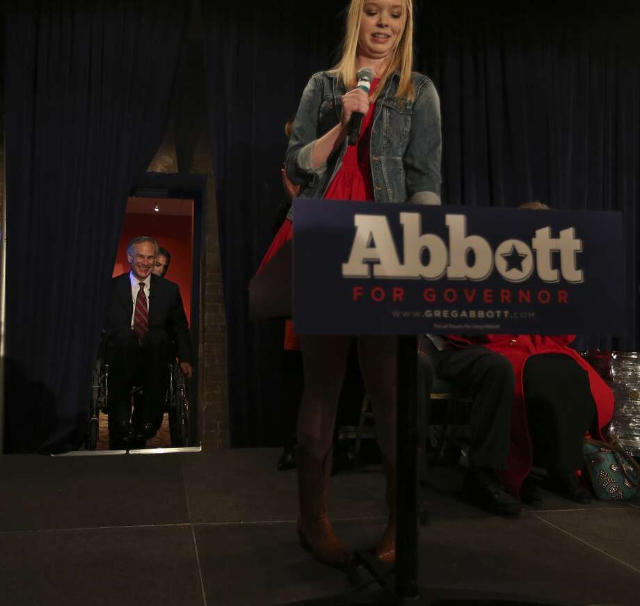 Texas Attorney General Greg Abbott is introduced by his daughter, Audrey, at Aldaco's Sunset Station, Tuesday, March 4, 2014. Abbott will face Democrat Wendy Davis in the governors race this coming November. Photo: Jerry Lara, San Antonio Express-News