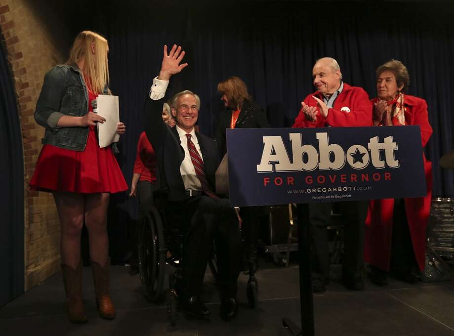 Texas Attorney General Greg Abbott is joined by family as he gives his acceptance speech at Aldaco's Sunset Station on primary election night, Tuesday, March 4, 2014. Abbott will face democrat Wendy Davis for the governor's office this coming November. Photo: Jerry Lara, San Antonio Express-News