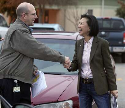Elisa Chan thanks  voter Ken Ebel at Barbara Bush Elementary School as she continues to work late during voting on March 4, 2014. Photo: Tom Reel, San Antonio Express-News