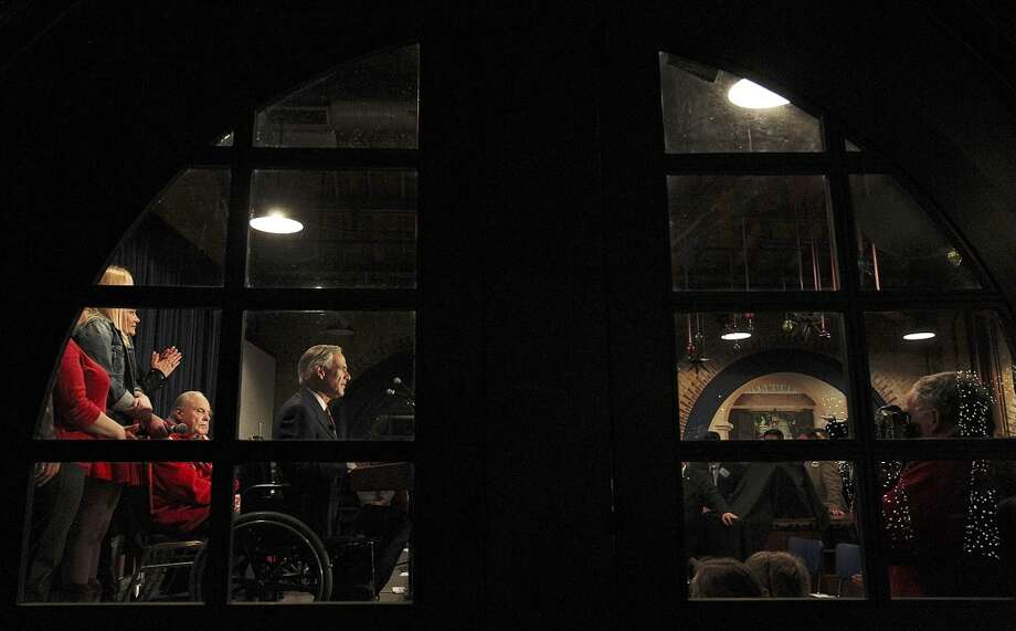 After winning the Republican nomination for Texas Governor, Texas Attorney General Greg Abbott is joined by family as he gives his acceptance speech at Aldaco's Sunset Station, Tuesday, March 4, 2014. He will face Democrat Wendy Davis in the November general election. Photo: Jerry Lara, San Antonio Express-News