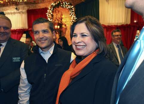 State Sen. Leticia Van de Putte (center), D-San Antonio and State Rep. Mike Villarreal, D-San Antonio, gather for election night results at Mi Tierra on Tuesday, Mar. 4, 2014. Van de Putte ran unopposed for the Democratic nomination for lieutenant governor. (Kin Man Hui/San Antonio Express-News) Photo: Kin Man Hui, San Antonio Express-News
