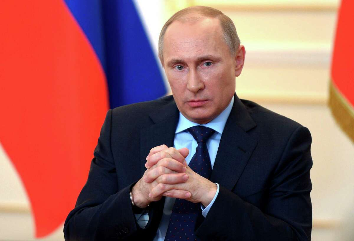 President Vladimir Putin answers journalists' questions on current situation in Ukraine at the Novo-Ogaryovo presidential residence outside Moscow on Tuesday, March 4, 2014. Putin accused the West of encouraging an
