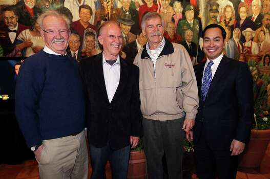 Bexar County Judge Nelson Wolff (second from left) joins former city mayors Phil Hardberger (left) and Howard Peak (second from right) along with current mayor Julian Castro for a photo-op at Mi Tierra as they monitor election night results with supporters on Tuesday, Mar. 4, 2014. Wolff ran against Bexar County Commissioner Tommy Adkisson. Photo: Kin Man Hui, San Antonio Express-News / ©2013 San Antonio Express-News