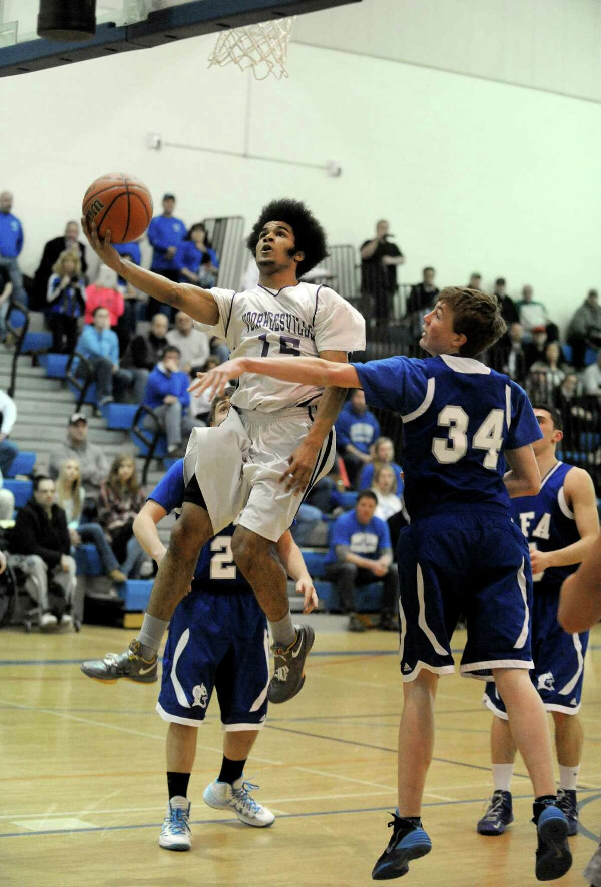 Voorheesville's Noah Crawford goes in for a basket during their Class B state regional boys' basketball game against Ogdensburg Free Academy on Tuesday March 4, 2014 in Saratoga Springs, N.Y. (Michael P. Farrell/Times Union)